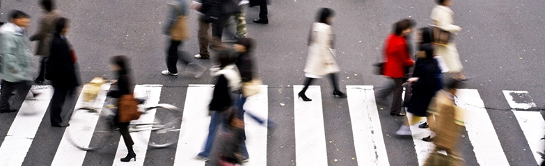 Picture of people crossing a road.